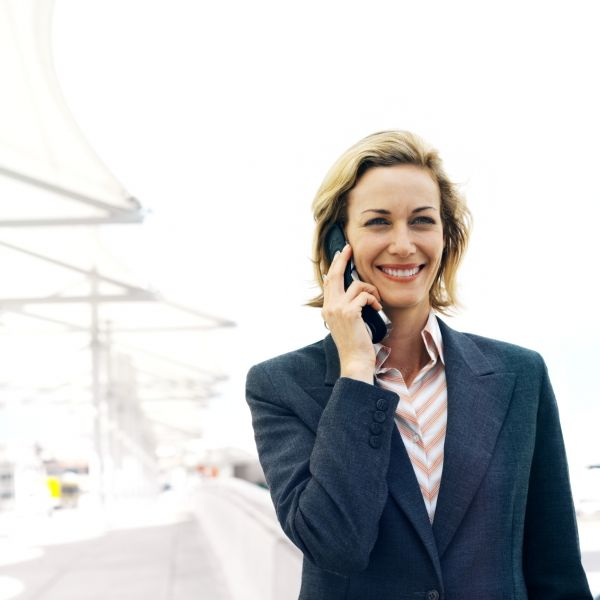 Businesswoman Talking On Mobile Phone Standing Outdoors-1 - W2